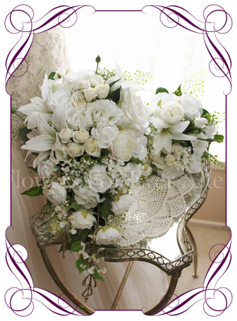 Silk artificial white classic elegant tear bridal bouquet with roses, peonies, lilies, ranunculi, baby's breath and fine foliage. Package set with bride, bridesmaids and buttons.