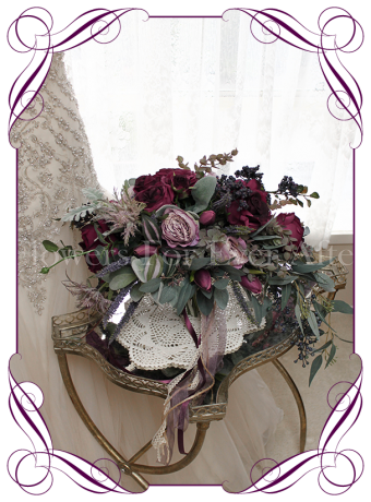 Silk artificial deep tone vintage style cascading bridal posy for purple lilac or navy wedding themes, with roses, peonies, navy berries, native gum leaves.