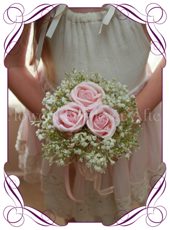 Silk artificial pink wedding flower girls posy bouquet with roses and baby's breath.
