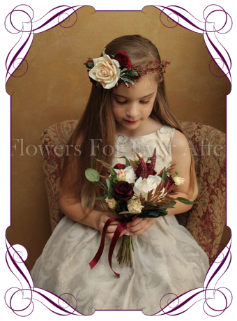 Silk artificial burgundy and cream rustic boho wedding flower girls posy bouquet with burgundy roses, cream peonies, blushing protea and native Australian gum foliage.