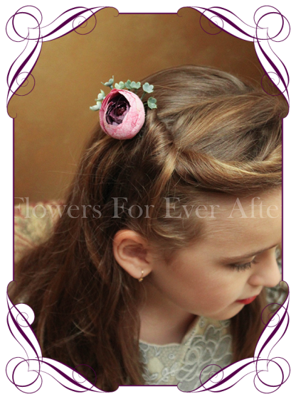Silk artificial boho rustic wedding hair floral pin with a deep purple ranunculi, and a fine foliage spray.