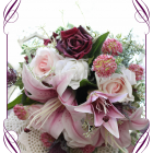 Silk artificial bridal bouquet of pink lilies with blush white and purple roses, sea holly thistle and foliage. Buy online.