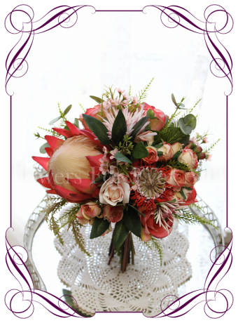 Silk artificial coral and pink roses and protea vibrant native bouquet. Buy online.
