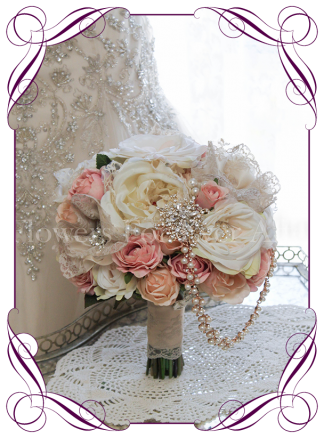 Silk artificial Rose gold and ivory blush rose bouquet with brooches, crystals, and handmade lace flowers. Made in Australia. Buy online.