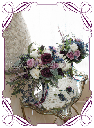 Silk artificial draping plum purple, mauve, navy, and lilac mix romantic wedding bridal posy bouquet. King protea, heather, roses, pepper berries. Buy online. Shipping world wide. Package