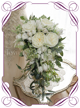 Silk artificial white mix romantic wedding bridal cascading tear shower bouquet. Peonies, roses, berries, gum leaves, blushing bride protea. Buy online. Shipping world wide