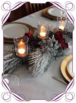 Winter frosted pine and burgundy red Christmas table candelabra centrepiece decoration. Buy online. Worldwide delivery.