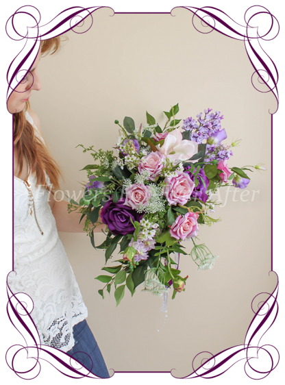 Silk artificial Cadbury purple and lilac large side spray cascading bridal bouquet elegant posy with mixed purple realistic quality flowers. For wedding bridal flower package. Made in Melbourne Australia. Shipping world wide.