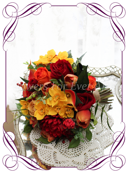 Silk artificial vibrant colorful red yellow and orange bridal brides posy wedding bouquet . Roses, dahlia, tulip, calla lilies lily, berries. jonquil daffodils, autumn / fall, harvest colors theme. Shipping world wide. Made in Melbourne Australia