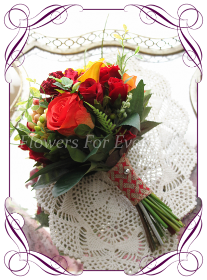 Silk artificial vibrant colorful red yellow and orange bridesmaid posy wedding bouquet . Roses, calla lilies lily, berries. jonquil daffodils, autumn / fall, harvest colors theme. Shipping world wide. Made in Melbourne Australia