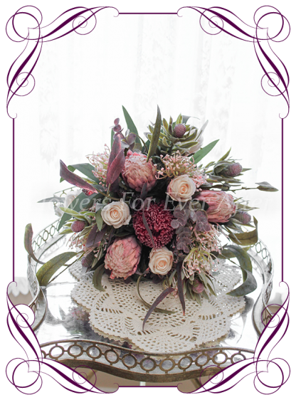 Silk artificial burgundy, dusty pink and blush elegant Australian native wedding bridal bouquet posy. Dusty pink protea, roses, native gum foliage leaves, banksia. Made in Melbourne Australia, post worldwide.