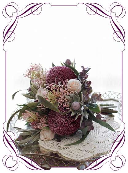 Silk artificial burgundy, dusty pink and blush elegant Australian native wedding bridesmaid bouquet posy. Dusty pink protea, roses, native gum foliage leaves, banksia. Made in Melbourne Australia, post worldwide.