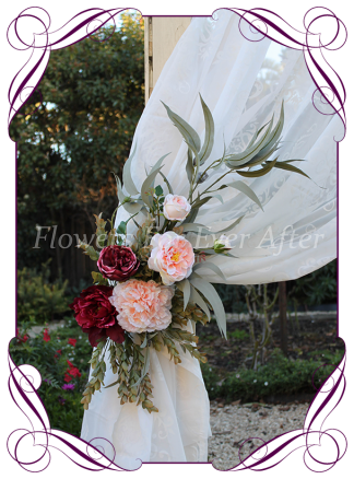 Silk faux flower wedding arbor arch corner tie back decoration florals featuring silk roses in burgundy and apricot and native gum leaves foliage. Made in Melbourne by Australia's best silk wedding florist. World wide shipping. Buy online.