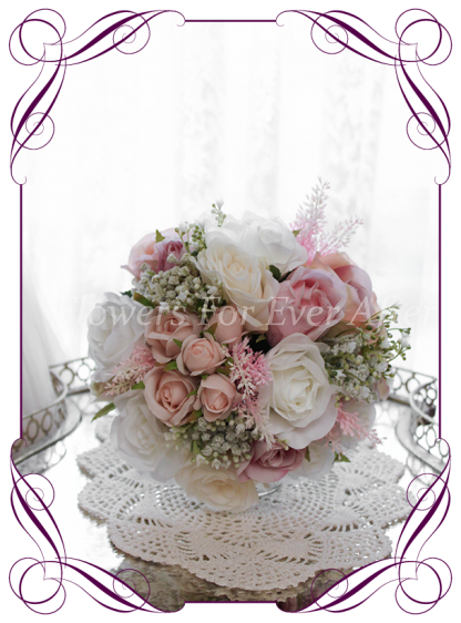 A Gorgeous Silk Artificial Bridesmaids Posy, featuring faux flower dahlia, babies breath, roses and textures in a classic bridal style, pink wedding flowers, traditional wedding bouquets. Made in Melbourne by Australia's Best Artificial Bridal Florist. Worldwide Shipping available