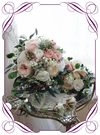 Silk faux flower cascading bridal Bouquet, brides bouquet featuring silk roses in blush, pink, ivory with baby's breath and native gum leaves foliage in a classical cascading tear style. Made in Melbourne by Australia's best silk wedding florist. World wide shipping. Package set. Buy online.