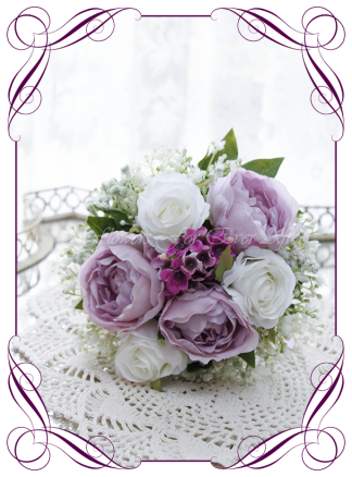 Silk artificial wedding bouquet ideas. Mixed purple lilac and white silk flowergirl bouquet flower girl wedding flowers. Roses, peonies, baby's breath. Cadbury purple flowers. Made in Melbourne. Buy online. Shipping worldwide.