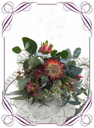 Silk artificial faux Australian native bridesmaids bouquet, wedding flowers. Burgundy and burnt orange rust, protea banksia gum leaf foliage. Made in Melbourne by Australia's best wedding florist. Buy online.